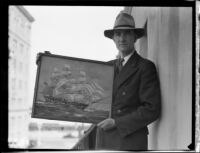 Arthur Beaumont, marine painter, holds a painting of the Constitution, 1933