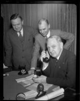 C. A. Holzer and H. W. Beck watch as Mayor Porter places the call to New York to initiate coast-to-coast flights, Los Angeles, 1932