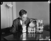 Los Angeles police sergeant Howard L. Barlow with fingerprint evidence collected from home of kidnapping and murder suspect William Hickman, 1927