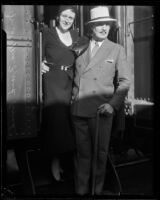 Mr. and Mrs. Frank Buck at the train station, Los Angeles, ca. 1930s?