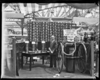 Arthur C. Burch with fire extinguishing equipment at an exhibition, 1921-1944