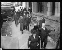 People walking into the courthouse for Arthur C. Burch murder trial, Los Angeles, 1921-1922