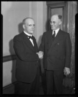 P. P. O'Brien and Henry B. R. Briggs, past and present postmasters, shaking hands, Los Angeles, 1943
