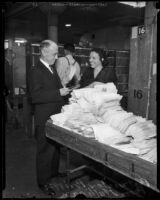 Postmaster Henry B. R. Briggs and Peggy Milligan in a postal facility, Los Angeles, 1934-1936