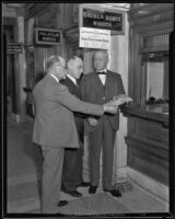 Postmaster Henry B. R. Briggs with two other men at a post office, Los Angeles, 1934-1926