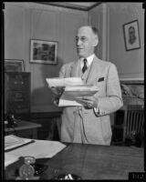 Postmaster Henry B. R. Briggs in his office, Los Angeles, 1934-1936