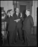 Postmaster Henry B. R. Briggs taking the oath of office administered by Judge McCormick, Los Angeles, 1934