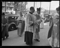 Bishop Cantwell, John Cawley and others entering the St. Patrick Catholic Church to attend the mass for St. John Bosco, Los Angeles, 1935