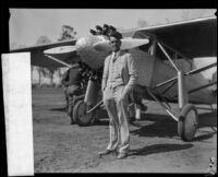 William Hawley Bowlus standing next to an Ryan single engine monoplane, 1920 -1939