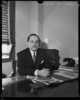 Judge Edward R. Brand seated at his desk, Los Angeles, 1930-1939