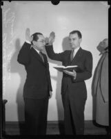 Judge Clarence L. Kincaid administering an oath to Judge Edward R. Brand, Los Angeles, 1930-1930