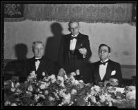 Robert Brennan, Milton H. Berry, and Rupert Hughes at luncheon, Los Angeles, 1935