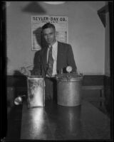 William P. Carr, Deputy Prosecutor, stands next to a still, Los Angeles, 1930-1933