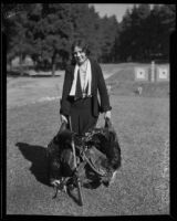 Betty Carrillo holding 2 dead turkeys at the Christmas turkey shoot in Elysian Park, Los Angeles, 1932