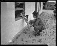 Seven-year-old witness Virginia Carter playing with dog, Los Angeles, 1935