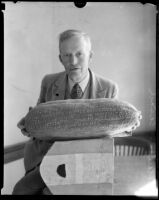 Roland C. Casad shows off his gourd carving, Los Angeles, 1925