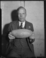 Roland C. Casad advertises the Los Angeles Times with a carved gourd, Los Angeles, 1925