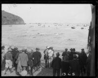 Spectators on the shore watch swimmers begin the Wrigley Ocean Marathon at Isthmus Cove, Santa Catalina Island, 1927