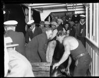 Rescued Wrigley Ocean Marathon swimmer assisted in a boat, 1927