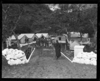 Frank Carpenter, assistant prison guard, ensures prisoners stay in campground, Malibu, 1921