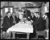Police officers and prison guards are served lunch at open-air prison camp, Malibu, 1921