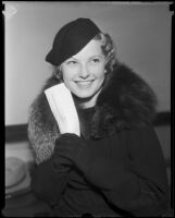 Actress Jean Chatburn smiles with a signed contract in hand, Los Angeles, 1934