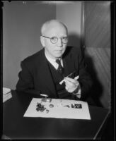Jules Charbneau with pieces from his collection of miniatures, Los Angeles, 1934