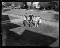 Alice, John, Dorothy, George, Teresa, Vincent, and Mary Cheap play a game in their front yard, Los Angeles, 1933