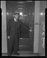 Chief of Police of San Marino, at the door to the county grand jury room, Los Angeles, 1935