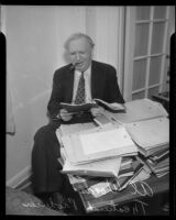 Theatrical producer Al Woods reads a script, 1920-1939