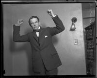 Distric Attorney Thomas Lee Woolwine with fists raised, Los Angeles, 1920-1923