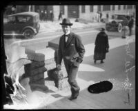 Distric Attorney Thomas Lee Woolwine walks up steps, Los Angeles, 1920-1923