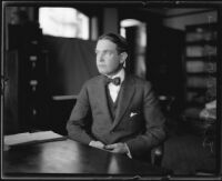 Distric Attorney Thomas Lee Woolwine sitting in an office, Los Angeles, 1920-1923
