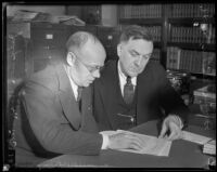 Leon Yankwich and Daniel Beecher examine threat note, Los Angeles, 1934
