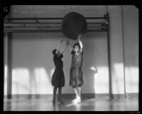 Selma Posner and Lillian Cassel play cage ball at the Y.W.C.A., Los Angeles, 1926