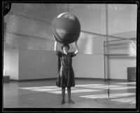 Charlotte Young plays cage ball at the Y.W.C.A., Los Angeles, 1926