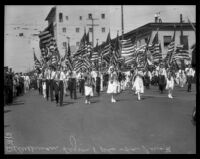 Members of the American Legion bearing flags at the La Fiesta de Los Angeles parade, Los Angeles, 1931