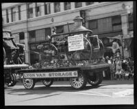 Hand-drawn steamer on view at a Transportation Day parade during La Fiesta de Los Angeles celebration, Los Angeles, 1931