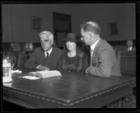 Joseph Scott in a courtroom with a woman (client?) and a man, Los Angeles, 1930s