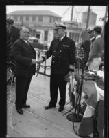 Mayor Frank Shaw and Admiral Thomas Senn shake hands an an official event, Los Angeles, circa 1933