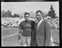 UCLA football coach Bill Spaulding and team captain Joe Fleming on UCLA playing field, Los Angeles, circa 1928