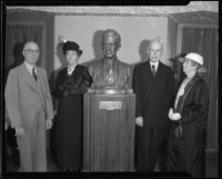 Dr. William A. Bryan, Julia Bracken Wendt, John S. McGroarty, and Mrs. A. S. C. Forbes pose with the bust of McGroarty, Los Angeles, 1934