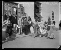 John S. McGroarty watches performers in Spanish style costumes, Southern California, 1920-1940