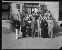 John S. McGroarty with performers in Spanish style costumes, Southern California, 1920-1940
