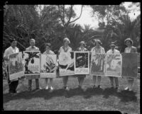 Otis Art Institute students holding posters that they created for the California Botanic Garden, Los Angeles, 1928