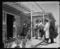 Lillian Gifford greets visitors at The Times' model home, Los Angeles, 1935