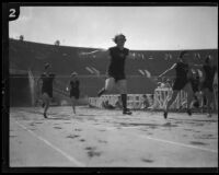 Lillian Copeland crossing the finish line in a race at the Coliseum, Los Angeles, circa 1924-1932
