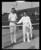 Henri Cochet, French tennis champion (R), shaking hands with a competitor at the Pacific Southwest Tennis Championships, Los Angeles, 1928