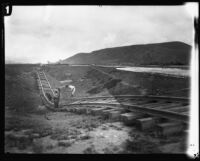 Railroad track twisted by the flood following the failure of the Saint Francis Dam, Santa Clara River Valley (Calif.), 1928