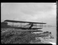 "Curtis JN-4 ""Jenny"" biplane stuck in mud after the flood resulting from the failure of the Saint Francis Dam, Santa Clara River Valley (Calif.), 1928"